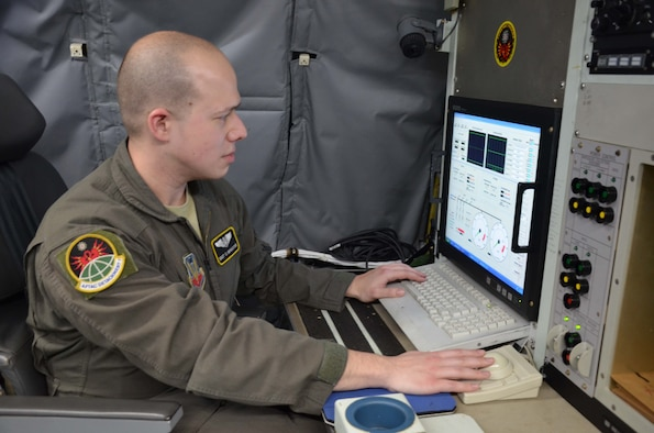 "U.S. Air Force Staff Sgt. Theodore ""TJ"" Bencoter, a special equipment operator with the Air Force Technical Applications Center's Detachment 1 at Offutt AFB, Neb., reviews technical collection information aboard the WC-135 Constant Phoenix.  The aircraft was on display at Patrick AFB, Fla., for members of the nuclear treaty monitoring center and base personnel to tour.   (U.S. Air Force photo by Susan A. Romano)"