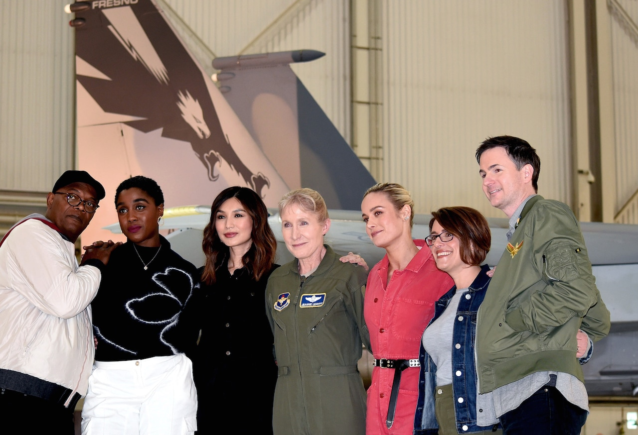Captain Marvel cast take photo with airman in front of F-15