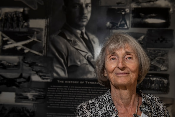Mary Tyndall Troff, daughter of World War I pilot Lt. Frank B. Tyndall, 2nd Bombardment Group, stands in front of a heritage mural inside the 325th Fighter Wing headquarters building during a base visit at Tyndall Air Force Base, Fla., Feb. 25, 2019. Mary and her daughters were invited to visit TAFB after she sent a letter about her concerns for the base and the well-being of Airmen after Hurricane Michael. (U.S. Air Force photo by Staff Sgt. Alexandre Montes)