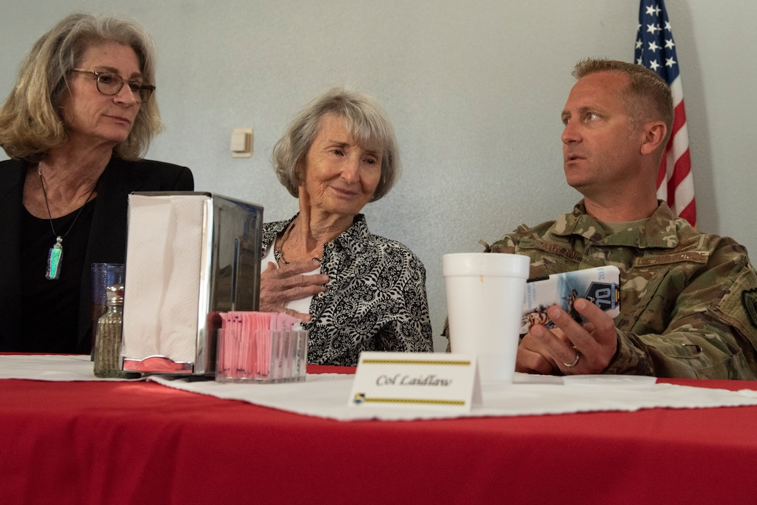 Nancy Troff, and mother Mary Tyndall Troff, daughter of World War I pilot Lt. Frank B. Tyndall, 2nd Bombardment Group, look at photos that 325th Fighter Wing Commander Brian Laidlaw saved from the initial Hurricane Michael destruction assessment during a meet and greet at Tyndall Air Force Base, Fla., Feb. 25, 2019. Mary and her daughters were invited to visit TAFB after she sent a letter about her concerns for the base and the well-being of Airmen after Hurricane Michael. (U.S. Air Force photo by Staff Sgt. Alexandre Montes)