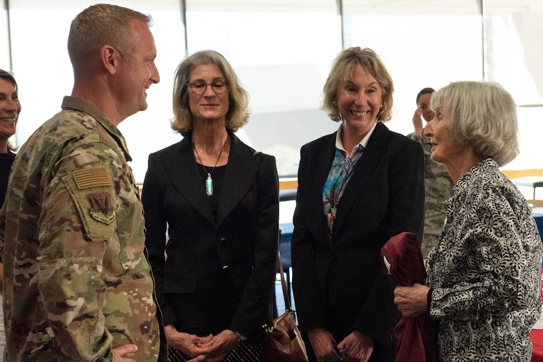 Col. Brian Laidlaw, 325th Fighter Wing commander, thanks Mary Tyndall Troff, daughter of World War I pilot Lt. Frank B. Tyndall, 2nd Bombardment Group, for visiting the base and meeting with the Airmen stationed here at Tyndall Air Force Base, Fla., Feb. 25, 2019. Mary and her daughters were invited to visit TAFB after she sent a letter about her concerns for the base and the well-being of Airmen after Hurricane Michael. (U.S. Air Force photo by Staff Sgt. Alexandre Montes)
