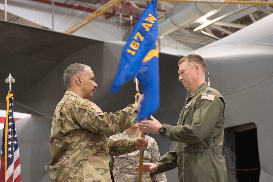 Lt. Col. Christopher Sigler accepts the 167th Mission Support guidon from Col. David Cochran, 167th Airlift Wing commander, during his assumption of command ceremony, March 3, 2019. (U.S. Air National Guard photo by Tech. Sgt. Michael Dickson)
