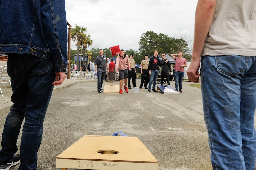 Students from the Navy Nuclear Power Training Command play a game of Cornhole during The Dive grand reopening ribbon cutting ceremony March 1, 2019, on the Naval Weapons Station.