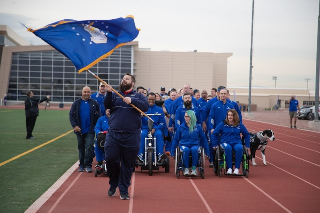 Approximately 110 Air Force athletes stand ready before the 6th Annual Air Force Wounded Warrior Trials opening ceremony at the Warrior Fitness Center on Nellis Air Force Base, Nevada, Mar. 1, 2019. Service members are participating in adaptive athletic reconditioning for lasting effects on physical and emotional recovery. (U.S. Air Force photo by Dave Long)