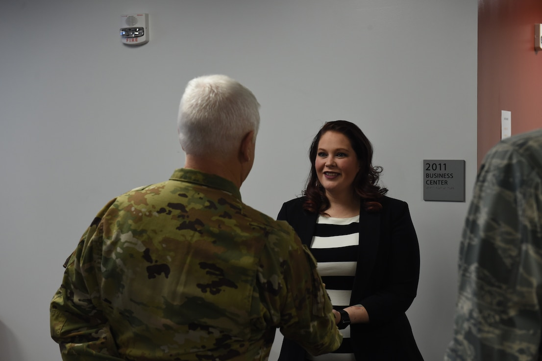Britny Marin is coined by Lt. Gen. Scott Rice, Director of the Air National Guard, February 13, 2019. Britny won 2018 Joan Orr Air Force Spouse of the Year Award at the Air National Guard level. (U.S. Air National Guard photo by Staff Sgt. Michael J. Kelly)