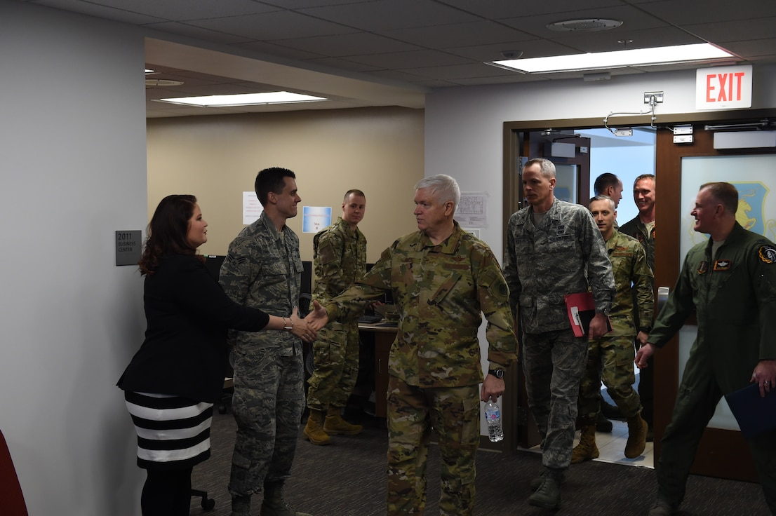 Britny Marin (left) and her husband Senior Airman Shane Marin (middle) are greeted by Lt. Gen. Scott Rice, Director of the Air National Guard, February 13, 2019. Britny won 2018 Joan Orr Air Force Spouse of the Year Award at the Air National Guard level. (U.S. Air National Guard photo by Senior Master Sgt. Robert Shepherd)