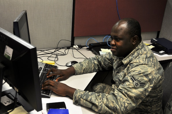 Airman 1st Class Williams Amo Ampomah, a client systems technician with the 445th Force Support Squadron communications element, troubleshoots a computer issue, one of the many tasks he does as the unit's client systems technician.