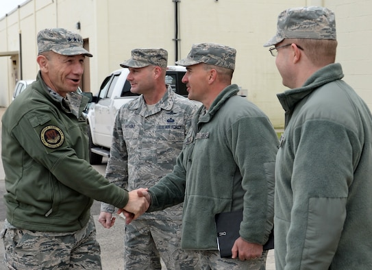 U.S. Air Force Gen. Mike Holmes, commander of Air Combat Command, is greeted by 67th Cyberspace Wing leaders during his visit to Joint Base San Antonio-Lackland, Texas, March 4, 2019. Holmes toured several Air Forces Cyber units to meet Airmen and gain knowledge about the cyber mission. (U.S. Air Force Photo by Tech. Sgt. R.J. Biermann)