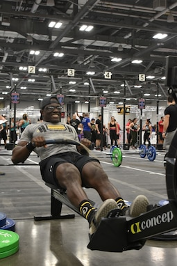 Smith performing a 30 calorie row on the row machine.