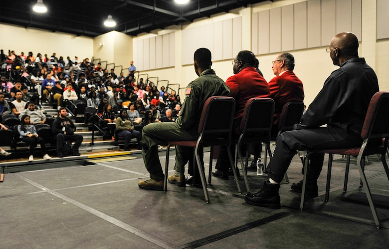 Capt. Alex Flowers, 14th Airlift Squadron C-17 Globemaster III pilot, and Fred Wilson, a representative of NASA, along with members of the South Carolina Spann Watson Chapter of Tuskegee Airman Inc., speak during a school presentation to honor Black History Month Feb. 28, 2019, at North Charleston High School, Charleston, S.C.