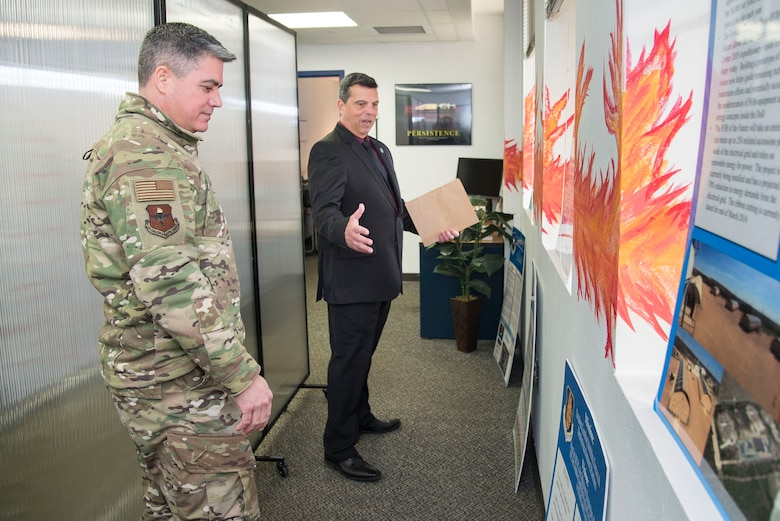 """Sean Harrington, Air Education and Training Command Innovation Advancement Division lead, highlights the capabilities of the """"Fire Pit"""" to Col. Jason Lamb, AETC's Director of Intelligence, Analysis, and Innovation, March 5, 2019, at Joint Base San Antonio-Randolph, Texas.  Mirrored to the wing level Spark Cell variant, the """"Fire Pit"""" is AETC's effort to invigorate innovation and support grassroots initiatives in a collaborative space designed to incubate and accelerate innovation initiatives and build a network with industry, academia, and the Department of Defense to provide rapid solutions to the needs of the warfighter.  (U.S. Air Force photo by Sean Worrell)"""