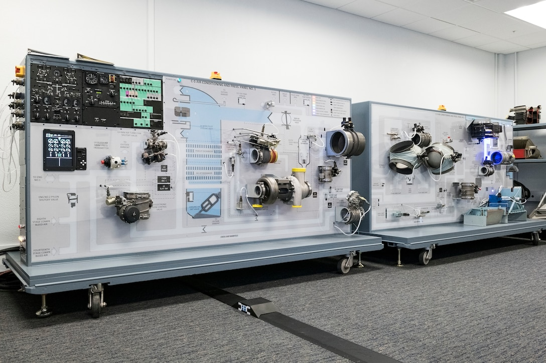 The C-5 Air Conditioning and Pressurization Systems Trainer, panels 1 and 2, have been reconfigured to replicate the current C-5M Super Galaxy system for a classroom environment Feb. 20, 2019, at the 373rd Training Squadron, Detachment 3, on Dover Air Force Base, Del. The AC & PST allows students to see and hear components move when switches are moved on the flight engineer's control panel. (U.S. Air Force photo by Roland Balik)