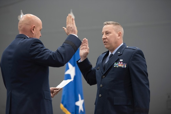 Brig. Gen. Ray Shepard takes the oath of office, administered by retired Maj. Gen. Eric Vollmecke, during Shepard's promotion ceremony at the 167th Airlift Wing, March 3, 2019. Shepard served as a Staff Judge Advocate at the 167th AW for approximately 10 years before moving on to serve as the State Staff Judge Advocate for the West Virginia Air National Guard and currently as the Chief of Staff of the WVANG. (U.S. Air National Guard photos by Tech. Sgt. Michael Dickson)