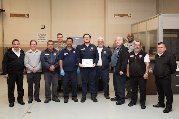"""Joshua Sandoval, 47th Maintenance Directorate aerospace ground equipment repair technician, was chosen by wing leadership to be the """"XLer"""" of the week, for the week of Feb. 25, 2019, at Laughlin Air Force Base, Texas. The """"XLer"""" award, presented by Col. Lee Gentile, 47th Flying Training Wing commander, is given to those who consistently make outstanding contributions to their unit and the Laughlin mission. (U.S. Air Force photo by Senior Airman Benjamin N. Valmoja)"""