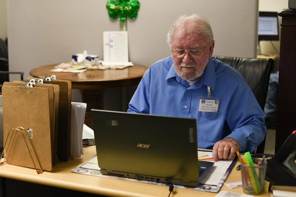 MCCONNELL AIR FORCE BASE, Kan.-- Len Barnes, volunteer tax accountant, sits at the tax center front desk, March 5, 2019, at McConnell Air Force Base, Kan. Barnes is one of the 14 volunteers who endured 40 hours of training to become a tax center volunteer. (U.S. Air Force photo by Airman 1st Class Alexi Myrick)
