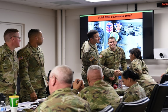 Brig. Gen. Kris A. Belanger, right, Commanding General, 85th U.S. Army Reserve Support Command, meets assigned Army Reserve battalion commanders and staff, operationally controlled by First Army's 5th Armored Brigade, during a command site visit, there, at Fort Bliss, Texas, March 1-3, 2019.