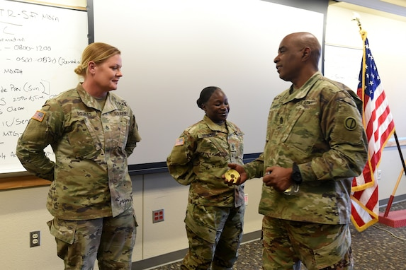 Command Sgt. Maj. Theodore Dewitt, right, Command Sergeant Major, 85th U.S. Army Reserve Support Command, presents coins to Soldiers from 1st Battalion, 382nd Regiment, 85th U.S. Army Reserve Support Command, operationally controlled by First Army's 5th Armored Brigade, during a command site visit, there, at Fort Bliss, Texas, March 1-3, 2019.
