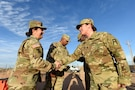 Brig. Gen. Kris A. Belanger, Commanding General, 85th U.S. Army Reserve Support Command, presents a command coin to Capt. Andrea Fasel, Alpha Team officer-in-charge, 3rd Battalion, 345th Regiment, 85th U.S. Army Reserve Support Command, operationally controlled by First Army's 5th Armored Brigade, during a command site visit, there, at Fort Bliss, Texas, March 1-3, 2019.