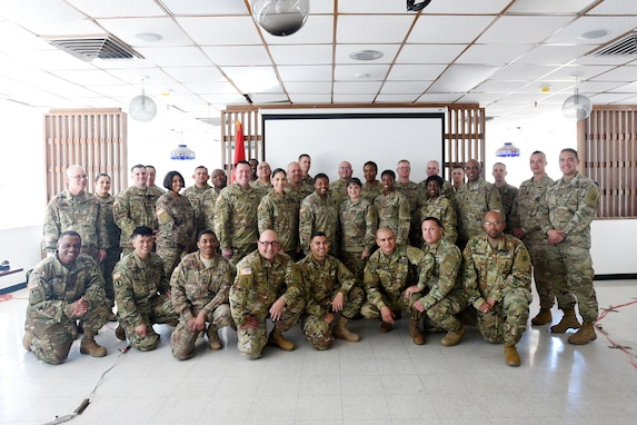 Army Reserve Soldiers assigned to the 85th U.S. Army Reserve Support Command and operationally controlled by First Army's 5th Armored Brigade Headquarters, pause for a group photo with the Brig. Gen. Kris A. Belanger, Commanding General, 85th Support Command, and Command Sgt. Maj. Theodore Dewitt, Command Sergeant Major, 85th USARSC, Mar. 3, 2019, at Fort Bliss, Texas.