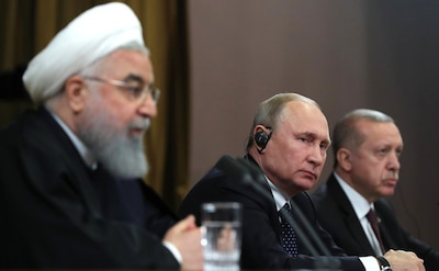 From left, Presidents Hassan Rouhani, Vladimir Putin, and Recep Erdogan during news conference following meeting in Sochi, February 14, 2019.