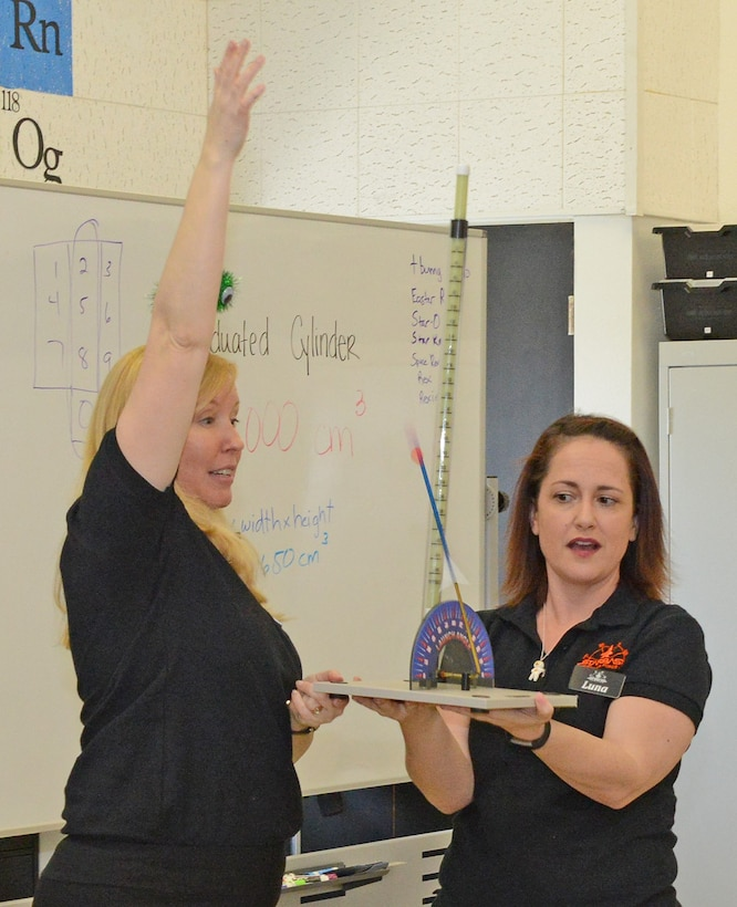 Janet Creech (left) and Caitlin Craig, STARBASE Instructional Systems specialists, launch a straw rocket on the first day of class for Edwards Air Force Base's STARBASE program March 5, 2019. Edwards is one of nine active duty bases with an official STARBASE program. The STEM-based program familiarizes elementary students, primary fifth and sixth graders, from all backgrounds to the world of science, technology, engineering and mathematics. (U.S. Air Force photo by Kenji Thuloweit)