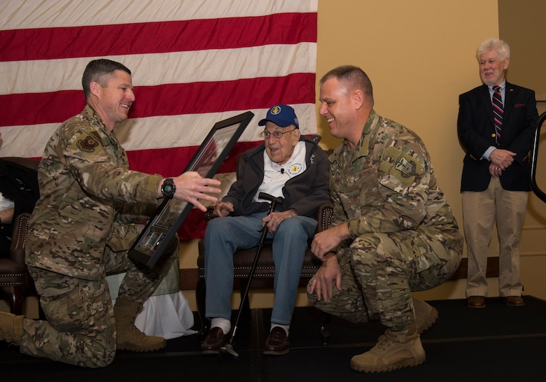 1st Special Operations Wing leadership presenting plaque to WW II veteran.