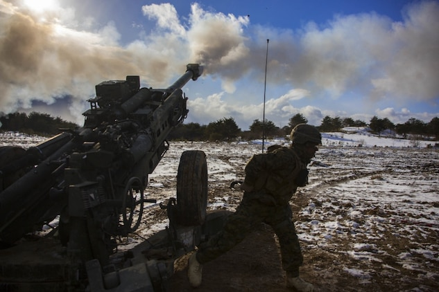 U.S. Marine Corps Lance Cpl. Johnathan Delgado, a field artillery Marine with 3rd Battalion, 12th Marine Regiment, 3rd Marine Division, fires a M777 Howitzer in the Ojojihara Maneuver Area, Miyagi Prefecture, Japan, Feb. 10, 2019. Marines with 3/12 are training in the Ojojihara Maneuver Area as part of the Artillery Relocation Training Program 18-4. ARTP is a routine training exercise that allows Okinawa-based Marines to conduct live-fire training in Japan. (U.S. Marine Corps photo by Lance Cpl. Christian Ayers)
