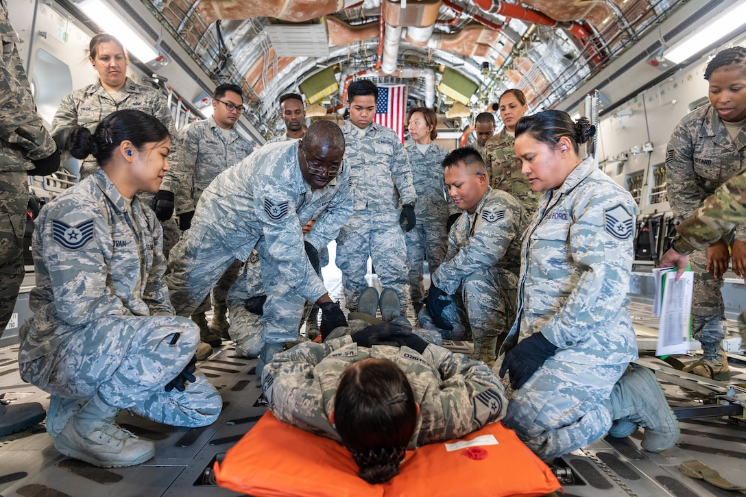 U.S. Air Force Tech. Sgt. Donahue Pinto, of Ewa Beach, Hawaii, a member of the Air Force Reserve's 624th Aeromedical Staging Squadron, provides instruction on how to properly secure a patient for movement during an aeromedical staging and aerial port training at Joint Base Pearl Harbor-Hickam, Hawaii, March 3, 2019.