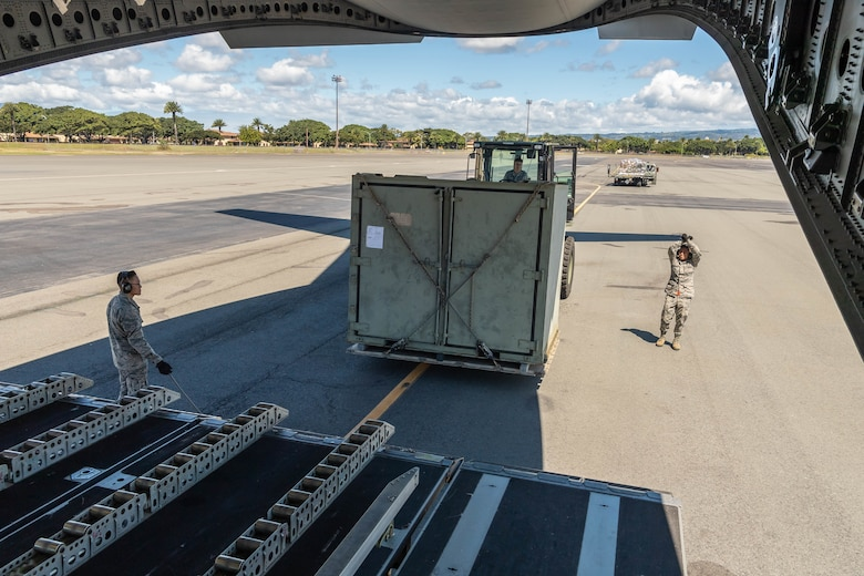 A team of Reserve Citizen Airmen from the 48th Aerial Port Squadron, load equipment onto a U.S. Air Force C-17 Globemaster III aircraft during an aeromedical staging and aerial port training at Joint Base Pearl Harbor-Hickam, Hawaii, March 3, 2019.