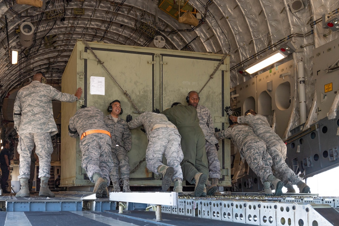 A team of Reserve Citizen Airmen from the 48th Aerial Port Squadron and Hawaii Air National Guard loadmasters load equipment onto a U.S. Air Force C-17 Globemaster III aircraft during an aeromedical staging and aerial port training at Joint Base Pearl Harbor-Hickam, Hawaii, March 3, 2019.