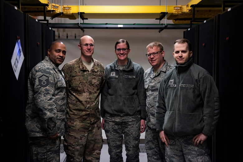 Leadership from the 8th Communications Squadron pose for a photo at Kunsan Air Base, Republic of Korea, Feb. 27, 2019. Kunsan became the first overseas Air Force base to have upgraded their email and increase storage size, paving the way for other bases to do the same. (U.S. Air Force photo by Senior Airman Stefan Alvarez)