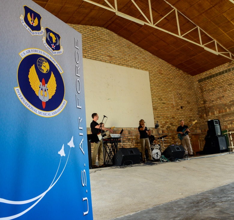 U.S. Airmen assigned to the U.S. Air Forces in Europe Band Touch N' Go perform sound checks at the Home de la vierge des Pauvres Gatagara/Nyanza in the Nyanza District, Rwanda, March 5, 2019. The USAFE Band played for HVP Nyanza as part of an outreach event. The band uses these events to further increase cultural ties and enhance the people-to-people relationship between the United States and its partners such as Rwanda. (U.S. Air Forces photo by Tech. Sgt. Timothy Moore)