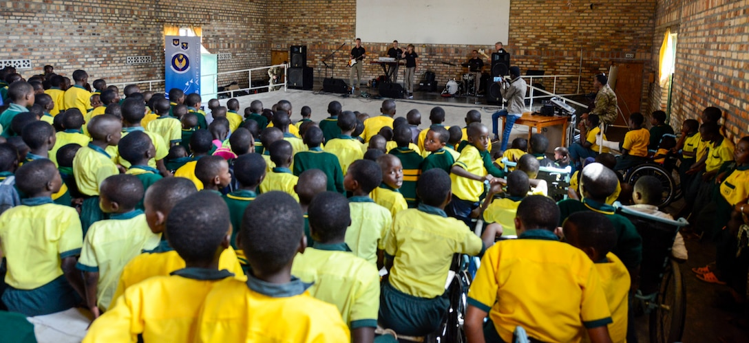 Students of the Home de la vierge des Pauvres Gatagara/Nyanza listen to music played by the U.S. Air Forces in Europe Band Touch N' Go in the Nyanza District, Rwanda, March 5, 2019. The USAFE Band played for HVP Nyanza as part of an outreach event. The band uses these events to further increase cultural ties and enhance the people-to-people relationship between the United States and its partners such as Rwanda. (U.S. Air Forces photo by Tech. Sgt. Timothy Moore)