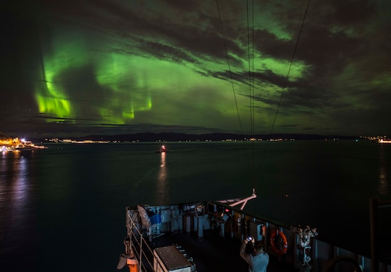 The Blue Ridge-class command and control ship USS Mount Whitney (LCC 20) is moored under northern lights in Trondheim, Norway, Nov 4, 2018.