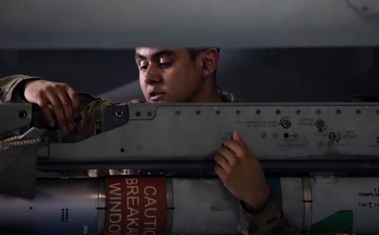 U.S. Air Force Airman 1st Class Daniel Nunez, 20th Aircraft Maintenance Squadron, 77th Aircraft Maintenance Unit load crew member, secures an AIM-9X Sidewinder on an F-16 Fighting Falcon during a Load Crew of the Year competition at Shaw Air Force Base, S.C., March 1, 2019.
