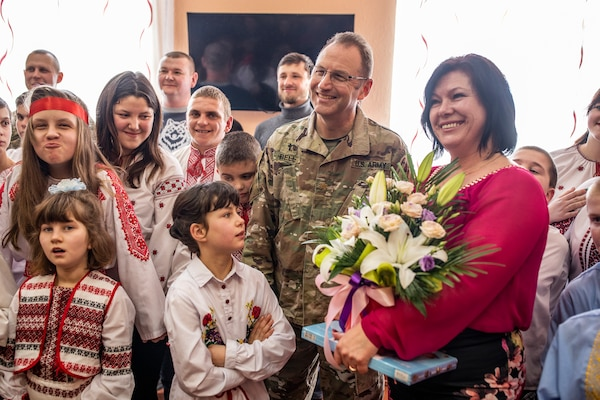Maj. Terry Bell from the Tennessee Army National Guard stands with the director of the Rehabilitation Center for the Children of Special Needs, Natalia Frankiv during a visit to the orphanage in Krakovets, Ukraine, March 4, 2019.