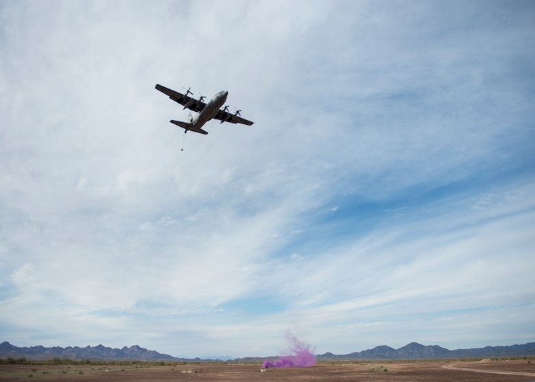 A C-130 Hercules from the 133rd Airlift Wing airdrops a Containerized Delivery System (CDS) over the Yuma Proving Grounds, Ariz. Feb. 26, 2019.
