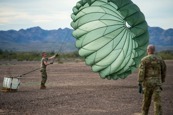 U.S. Air Force Staff Sgt. Nicholas Warren, an air transportation specialist with the 133rd Logistics Readiness Squadron, recovers Low Cost Low Altitude (LCLA) equipment after an airdrop mission at the Yuma Proving Grounds, Ariz. Feb. 26, 2019.