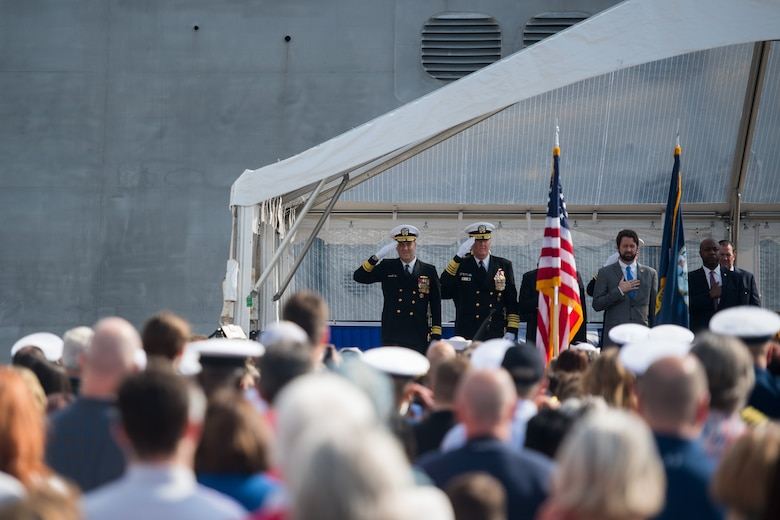Members of the official party salute the colors at the USS Charleston (LCS-18) commissioning ceremony March 2, 2019, in Charleston, S.C.