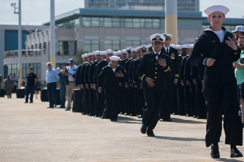 Crew members of the USS Charleston (LCS-18) officially man the ship for the first time at its commissioning ceremony March 2, 2019, in Charleston, S.C. The USS Charleston—a Littoral Combat Ship intended for more shallow waters than typical Navy vessels—is the sixth naval ship named after the city. Although the ship will be stationed in San Diego, CA, the captain and members of the crew will make annual trips to Charleston to interact with the city and work with the Navy League of Charleston to maintain the relationship between the namesake city and the ship.