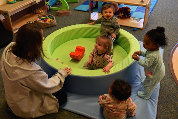 Amy Roberts, 20th Force Support Squadron Child Development Center (CDC) caregiver, plays with the infants in her care at Shaw Air Force Base, S.C., Feb. 25, 2019.
