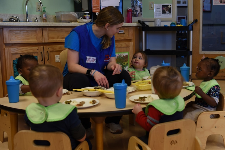 Taylor Colliver, 20th Force Support Squadron Child Development Center (CDC) caregiver, feeds lunch to the children in her care at Shaw Air Force Base, S.C., Feb. 25, 2019.