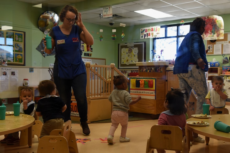 Children and 20th Force Support Squadron Child Development Center (CDC) caregivers clean up after lunch at the CDC at Shaw Air Force Base, S.C., Feb. 25, 2019.