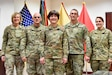 The 416th Theater Engineer Command and 647th Regional Support Group command teams pause for a photo March 1, 2019, in Wichita, Kansas.   Pictured are (L-R) Chief Warrant Officer 5 Teri Beatty, 416th TEC command chief warrant officer, Command Sgt. Maj. Michael Boyd, 416th TEC command sergeant major, Maj. Gen. Miyako Schanely, 416th TEC commanding general, Col. Jason Garcia, 647th RSG commander, and Command Sgt. Maj. Karen Logan, 647th RSG command sergeant major. Command teams and staff from the 647th Regional Support Group and subordinate units gathered to conduct their yearly training briefs with the 416th Theater Engineer Command leadership.