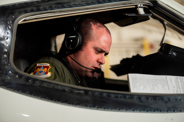Maj. Taylor Todd completes a pre-flight checklist on-board a C-21 prior to take off for a training flight at Scott Air Force Base, Illinois. Assigned to the 375th Operations Group, he is the C-21 Avionics Upgrade Program chief tasked to oversee a $38 million avionics upgrade to the aircraft. The new avionics and communications suites will expand the aircraft's reach, effectiveness, and capability, and come in time to meet Federal Aviation Administration's 2020 equipment mandate to keep increasingly congested airspace safe. 