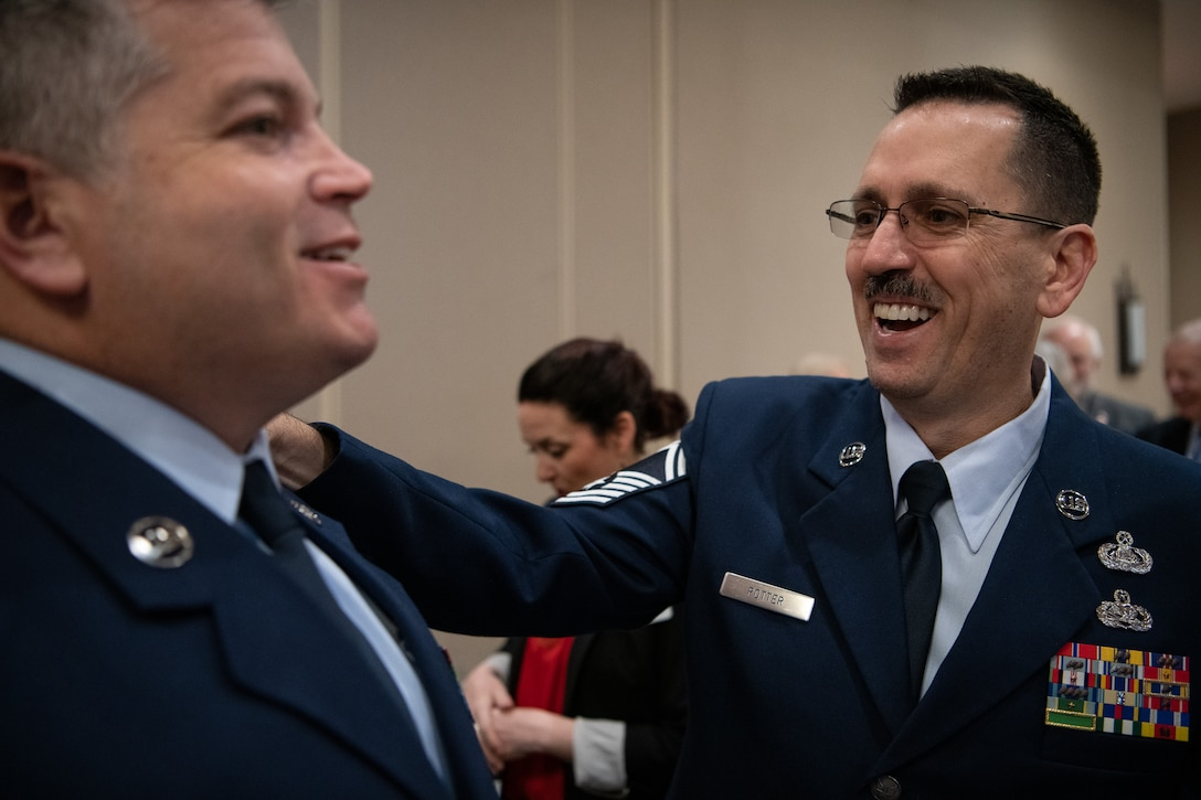 Oklahoma Air National Guard Chief Master Sgt. Anthony Potter (right), senior enlisted manager assigned to the 205th Engineering and Installation Squadron (205th EIS) at Will Rogers Air National Guard Base, Oklahoma City, shares a laught with Oklahoma Air National Guard Master Sgt. Bryan Whittle, also assigned to the 205th EIS, after the American Red Cross of Oklahoma honored Whittle as their military hero of the year during the 2019 Heroes Breakfast in Oklahoma City, March 5, 2019. Whittle was one of eight people honored for actions in six categories – including military, first responder, healthcare professional, community impact, disaster services and youth – during the first ever Red Cross Heroes Breakfast in Oklahoma City. (U.S. Air National Guard Photo by Tech. Sgt. Kasey M. Phipps)