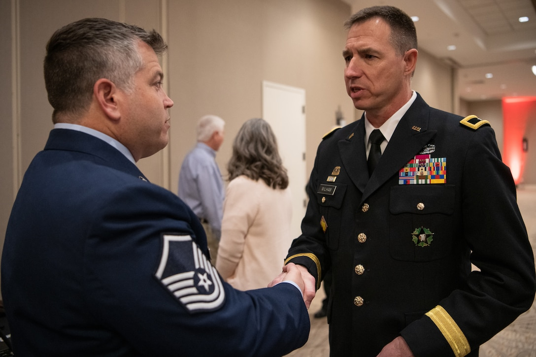 Oklahoma Army National Guard Brig. Gen. Louis Wilham, assistant adjutant general - Army, assigned to Joint Force Headquarters in Oklahoma City, coins Oklahoma Air National Guard Master Sgt. Bryan Whittle, assigned to the 205th Engineering and Installation Squadron at Will Rogers Air National Guard Base, Oklahoma City, after Whittle was named  the military hero of the year by the American Red Cross of Oklahoma during the A2019 Heroes Breakfast in Oklahoma City, March 5, 2019. Whittle was one of eight people honored for actions in six categories – including military, first responder, healthcare professional, community impact, disaster services and youth – during the first ever Red Cross Heroes Breakfast in Oklahoma City. (U.S. Air National Guard Photo by Tech. Sgt. Kasey M. Phipps)