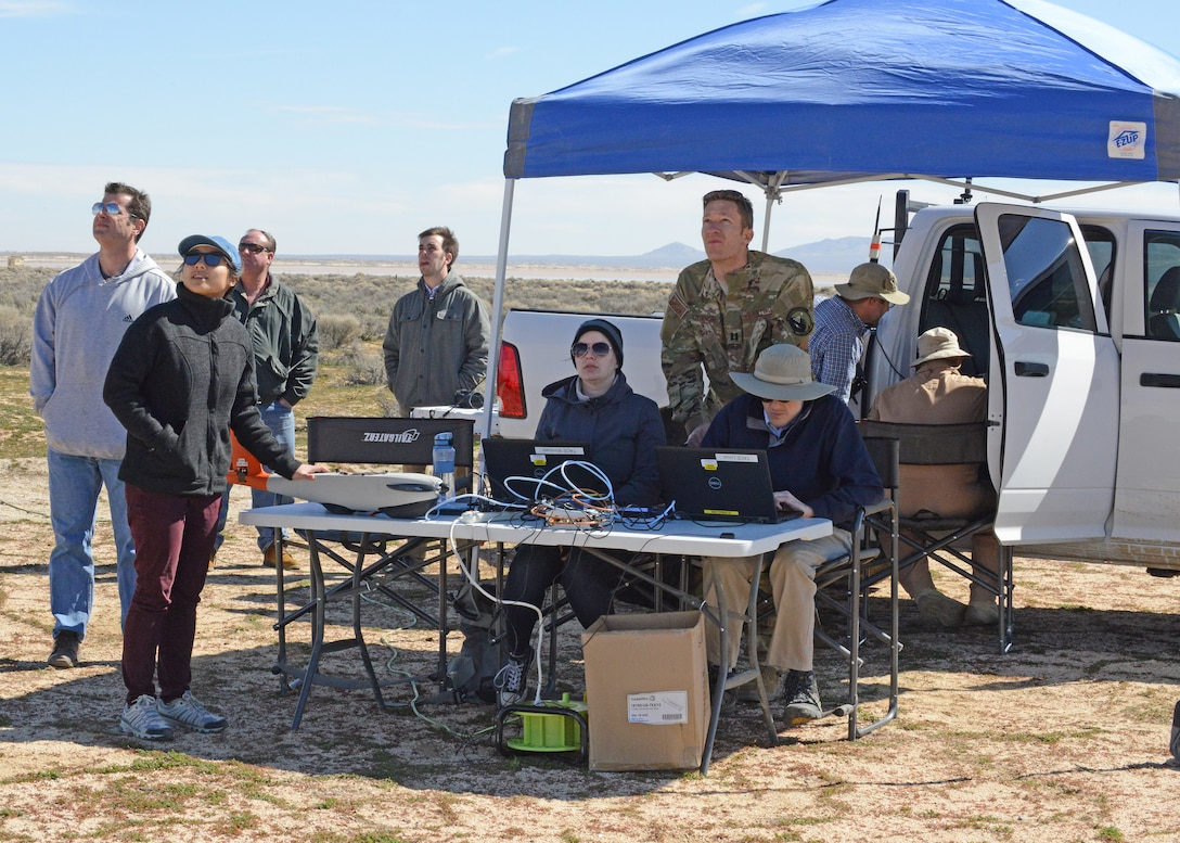 The 412th Test Wing's Emerging Technologies Combined Test Force Autonomy test team monitors a small unmanned aircraft system Feb. 27 during the ET CTF's first autonomy flight test. (U.S. Air Force photo by Kenji Thuloweit)