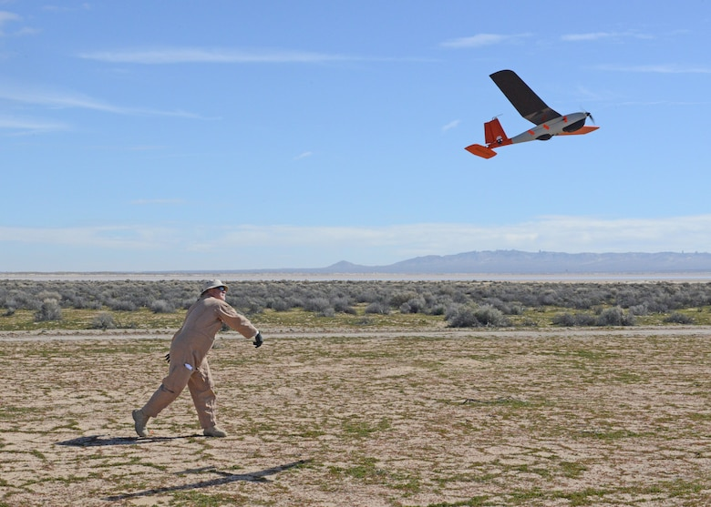 David Freeman, 412th Test Wing Emerging Technologies Combined Test Force, hand launches a small unmanned aircraft system in the north part of Edwards Air Force Base, California, Feb. 27. The ET CTF conducted its first autonomy flight test Feb. 26-27. (U.S. Air Force photo by Kenji Thuloweit)