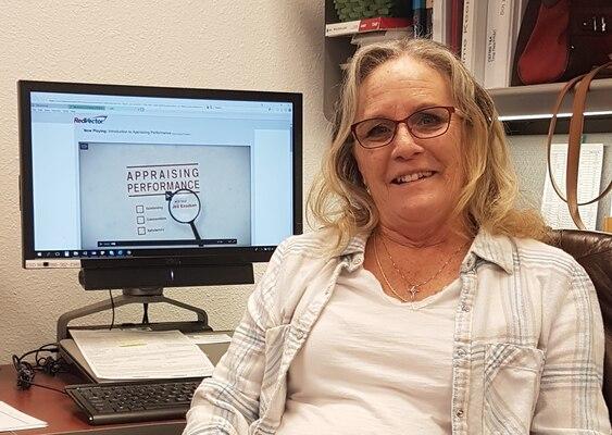 Joanne Deleon sits at her workstation, Nov. 14, 2018.